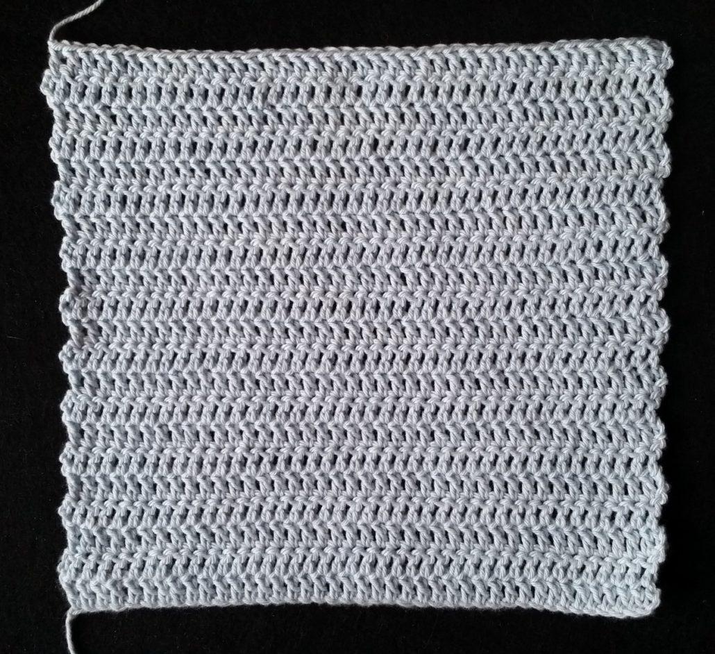 færdig hæklet tæppe billed af det færdig hæklet tæppe i stangmasker