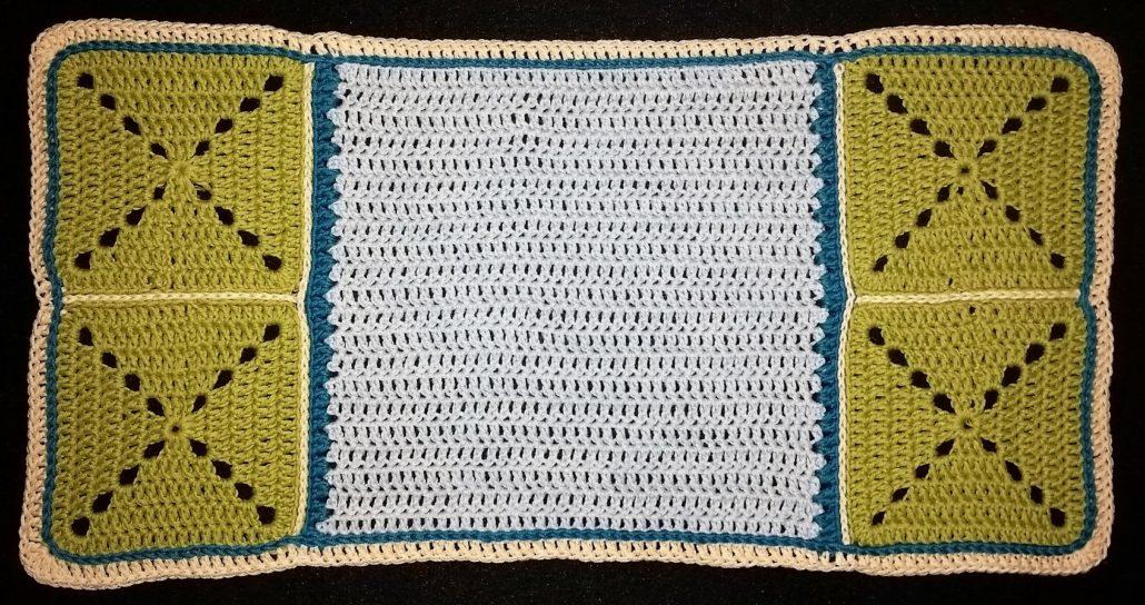 kædemaske kant billed af kædemaske kant i alle stangmasker i kanten på det stribet tæppe