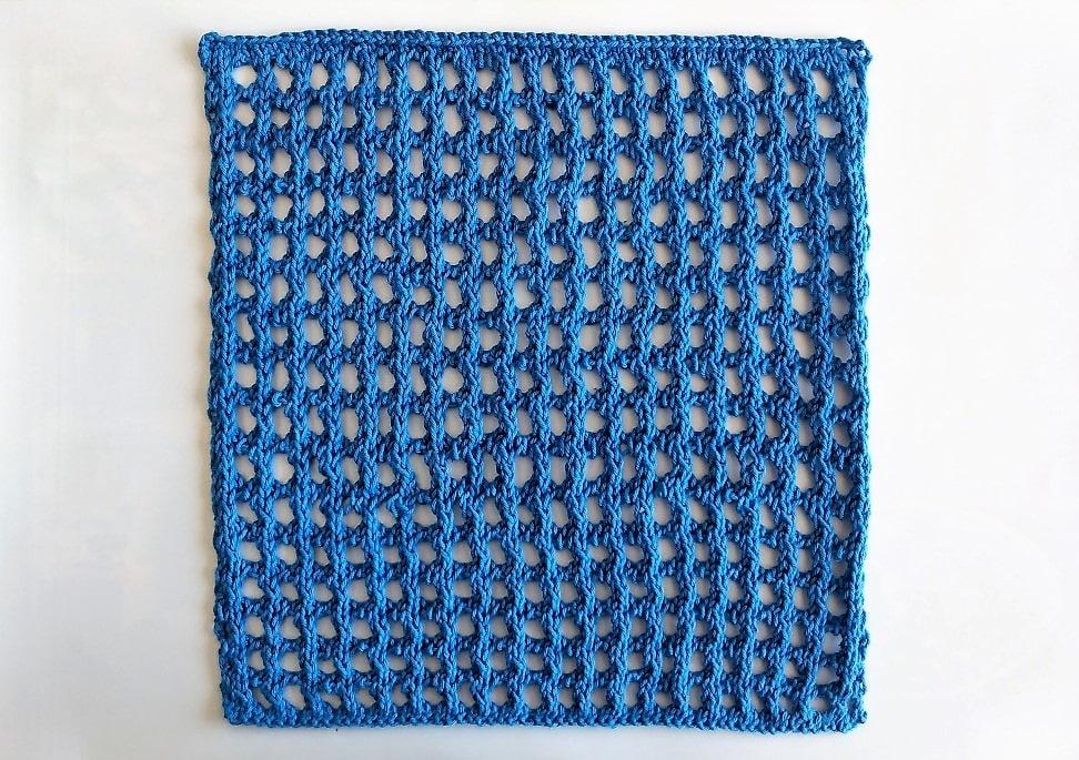 Hullet vaskeklud strikkeopskrift i det falske hæklesøms strikkemønster